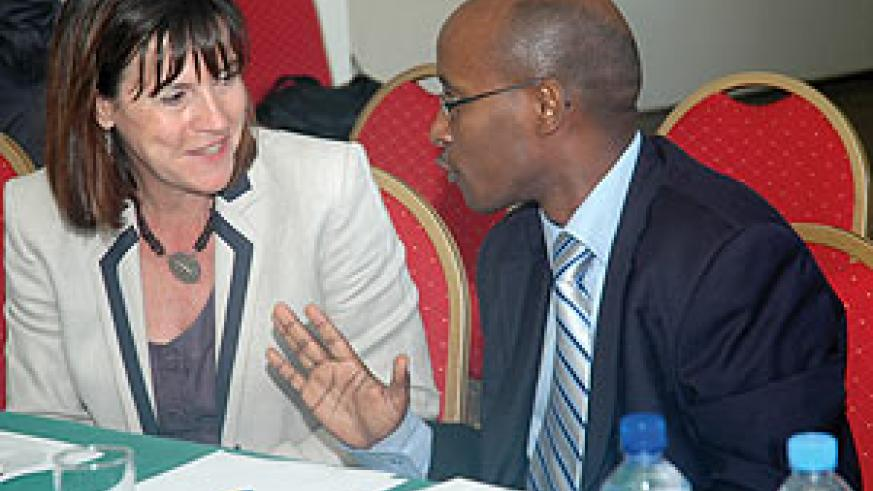 ICT Minister Ignace Gatare chatting with Janet Longmore the President & CEO of Digital Opportunity Trust during the launch on Monday.( Photo/ F. Goodman )