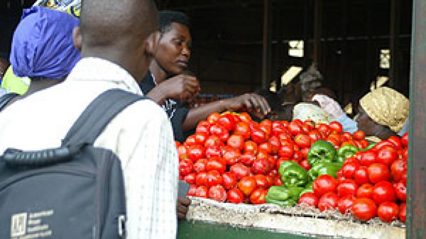 Traders  selling tomatoes in Kimironko market.(File photo)