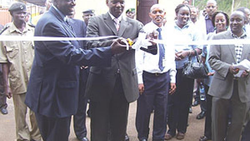 The PS in the Ministry of E.A.C Affairs (L), Robert Ssali flanked by Uganda's Ambassador to Rwanda, Richard Kabonero, at the launch of the one-stop border post (Photo A, Gahene)