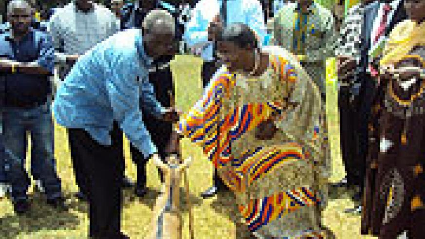 The Minister of Gender, Jeanne A'rc Mujawamariya, handing over one of the goats  (Photo; S. Rwembeho)