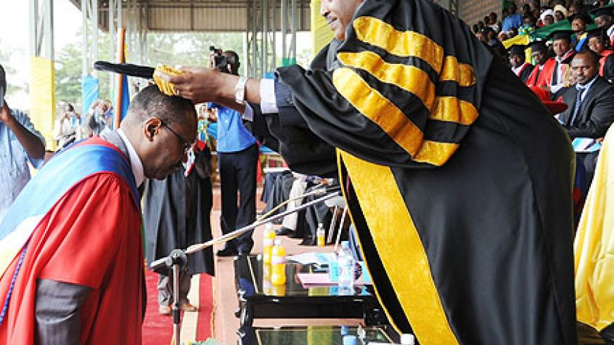 Dr Hamadoun Toure being awarded an Honorary degree by Dr Charles Muligande. (Photo J Mbanda)