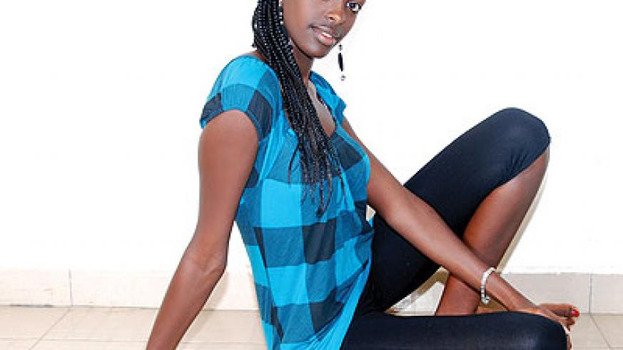 Miss KIST, Clarisse Nshuti, in cool leggings and a fitting top.