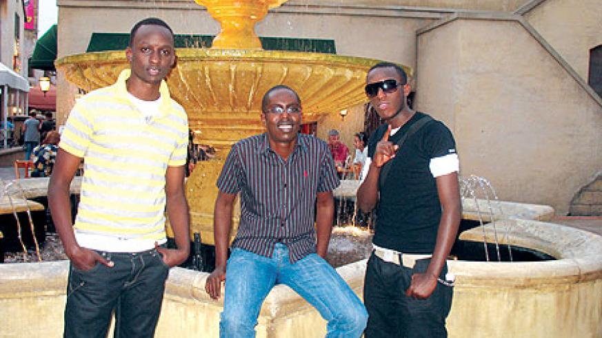(L-R) Meddy, Aimable Kubana, and The Ben pose for a photo.