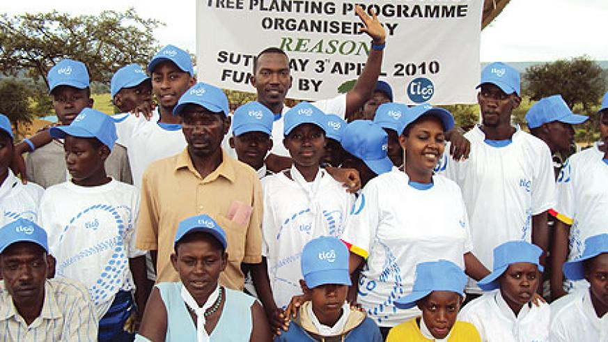 TIGO staff and pupils of Rwisirabo primary school pose for a photo after planting trees. (Photo/ S. Rwembeho)