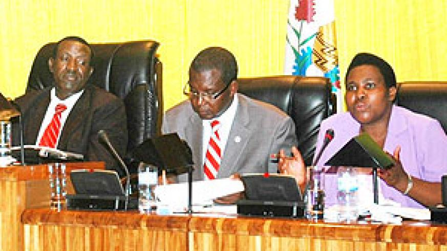 MP Evariste Kalisa (middle) tabling the findings of his committee before parliament yesterday (Photo F Goodman)