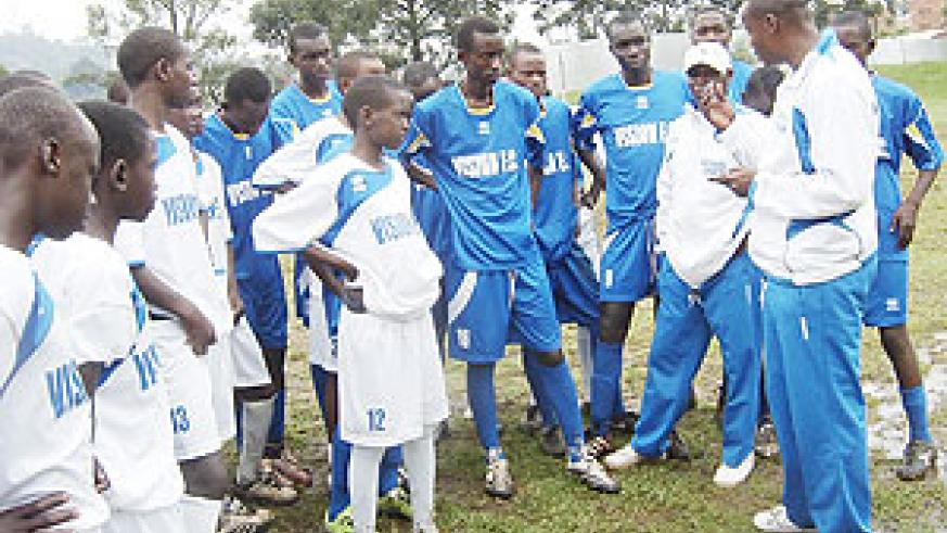 Vision Football Academy Head Coach Kassim Rugamba (R) giving tips to his team during a training session at Lugogo, Kampala, Uganda. (Courtesy photo)