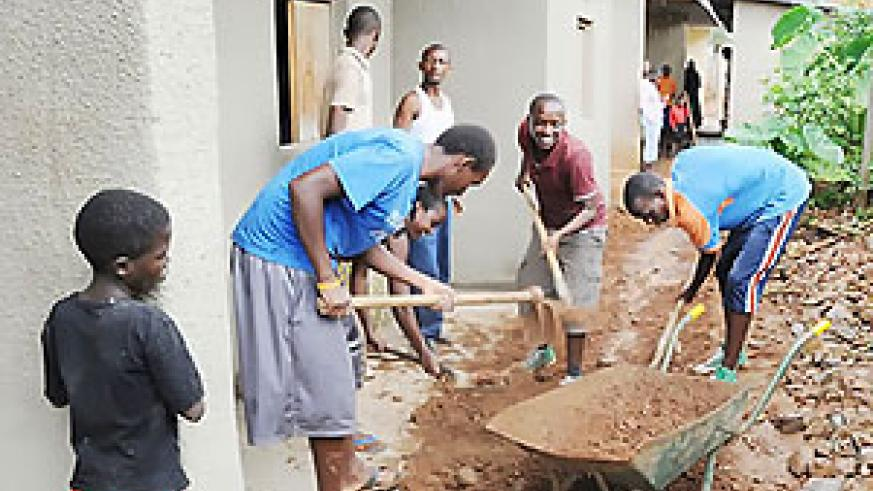 Youth from Evangelical Restoration Church during the renovation of the widows_ houses in Kimironko.