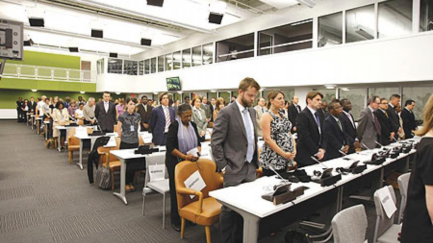 Participants standing to honour 1994 Genocide victims at the 16th commemoration ceremony in New York. (Courtsey Photo)
