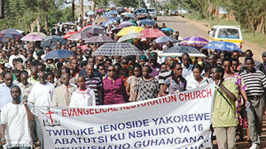 Members of the Evangelical Restoration Church marching from Kacyiru to Kigali Genocide memorial centre where they donated 500.000Frw. (Photo/ J. Mbanda)
