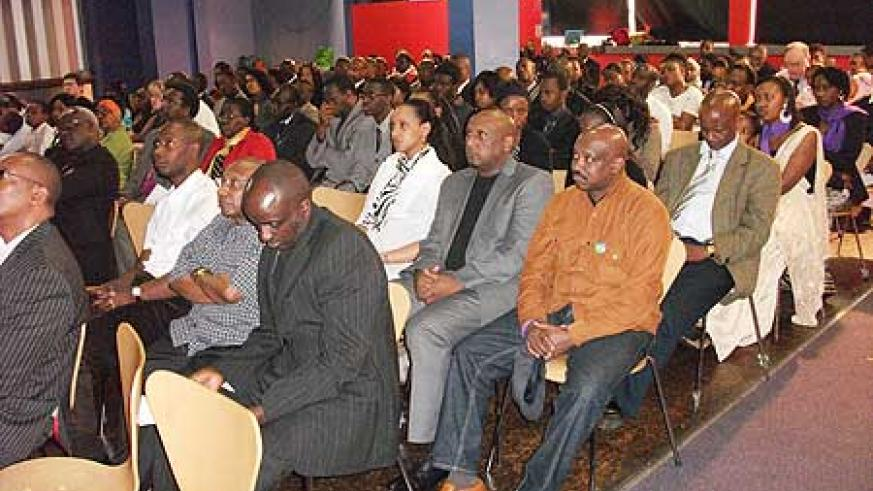 The audience attentively listen to presentations during the commemoration event in Birmingham, United Kingdom (Photo Rose Ingabire)