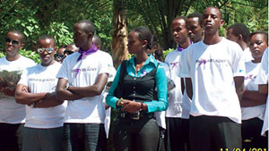 Models (clad in white t-shirts) and Miss Rwanda at Gisozi memorial site.