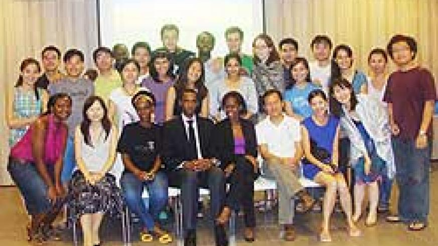 Students at the Singapore's Lee Kuan Yew School of Public Policy in a group photo with Paul Kayoboke (Courtsey Photo)