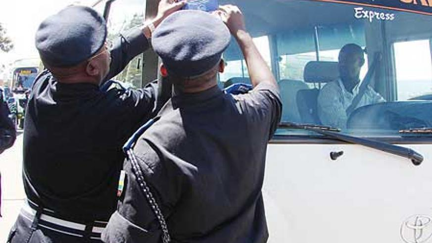 Top Police officers put a sticker on a passenger service van during last year's traffic week (File Photo)