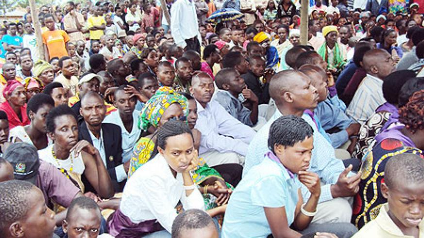 Nyarubuye residents listen to testimonies of survivors. (Photo: S. Rwembeho)