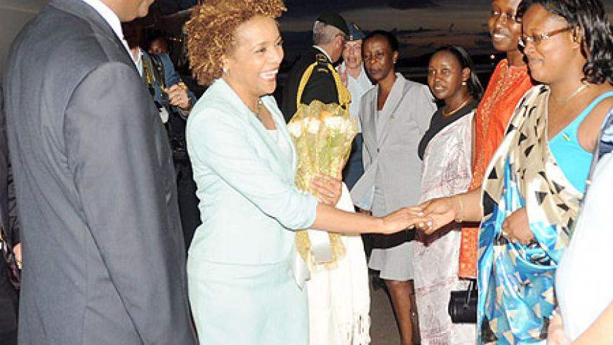 The Governor General of Canada, Michaelle Jean, greeting Rwandan officials on her arrival last evening. She was received by Prime Minister Bernard Makuza  and a host of senior government officials. (Photo J Mbanda)