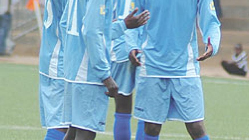 Rayon players share ideas during a Primus league encounter with Atraco. The Blues are desperate to reach the knock out stage of the Kagame Cup. (File Photo)