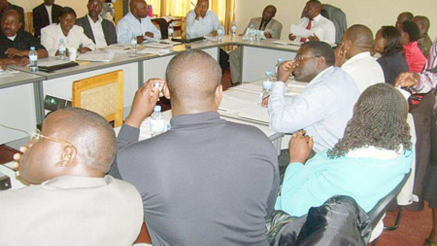 Governor Bosenibamwe together with district leaders during a meeting to evaluate development activities in the province. (Photo: A. Gahene)