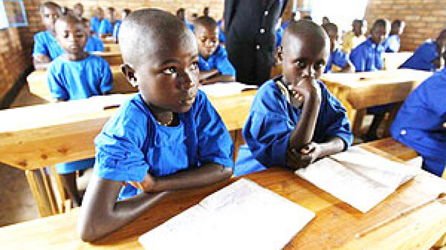 At school. These pupils will sit their PLE examinations in English this year.