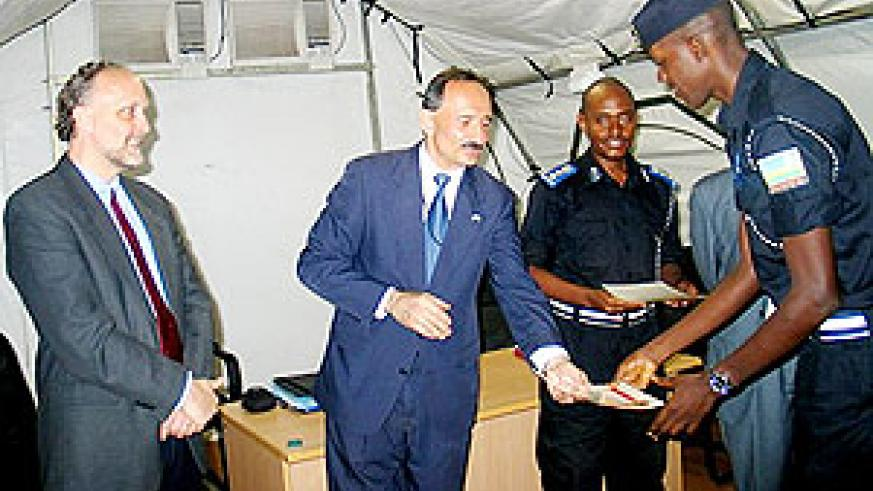 USAID's Rick Dannielle handing over certificate to one of the officers who completed the course (Courtesy Photo)