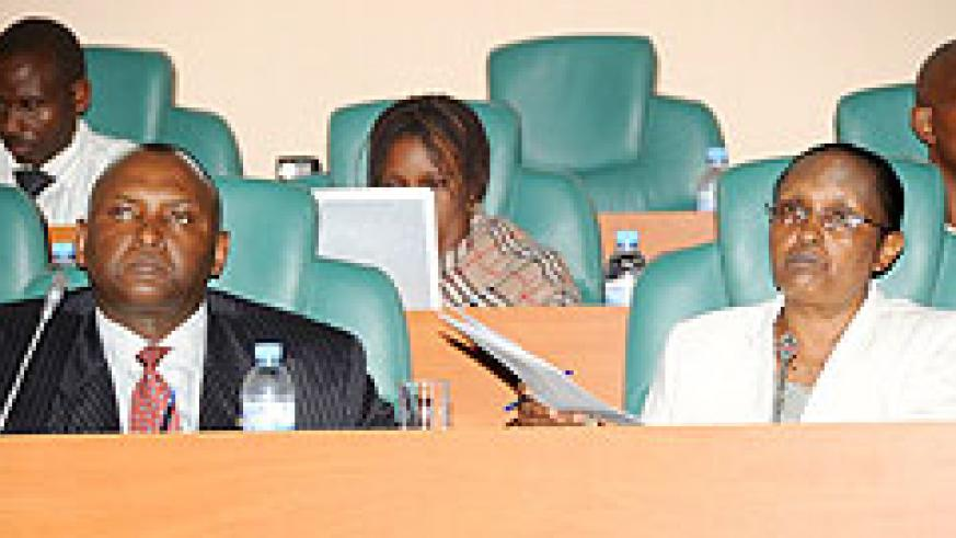 Senators Faustin Munyakabera (L) and Agnes Kayijire during the presentation of the report yesterday. (Photo; J Mbanda)