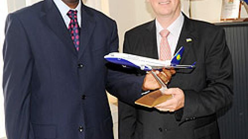 The outgoing CEO of RwandAir John Mirenge (L) and the new company CEO Rene Janata yesterday (Photo; J. Mbanda)