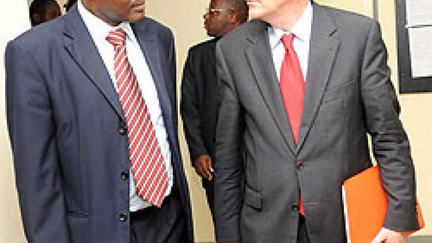 The Minister of Education Dr.Charles Murigande chatting with Clement Duhaime after their meeting yesterday. (Photo/ J. Mbanda)