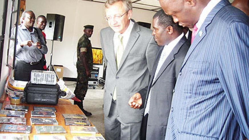 OIF Administrator General, Clément Duhaime, being taken around the Nyamagabe library yesterday, extreme right is Minister of Culture and Sports Joseph Habineza (Photo; P. Ntambara)