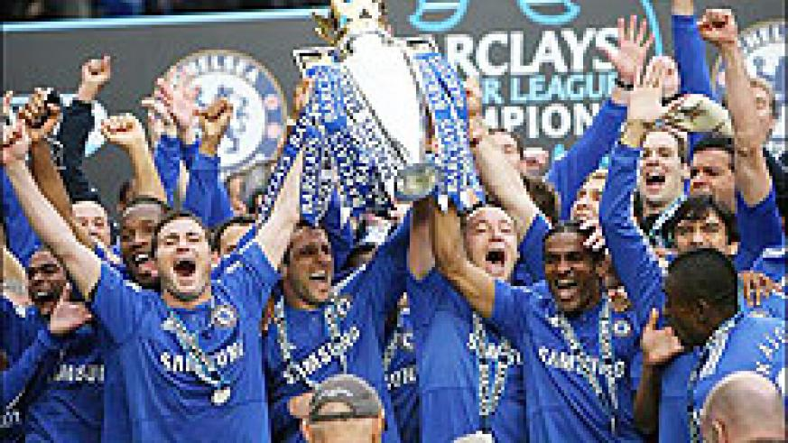 Chelsea players show off their latest premier league title after last evening's 8-0 victory over Wigan at Stamford Bridge.