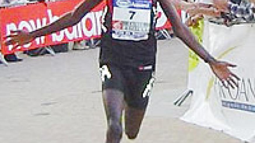 Dieudonne Disi reacts after crossing the finishing line in a previous even in France. (File photo)