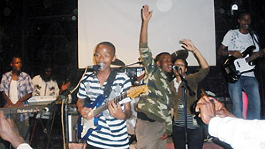 The lead singer of Kids voice, Patrick  Nteziryayo works up the crowd.