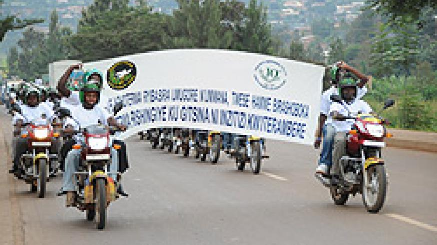 Motorcycle taxi operators in a procession yesterday. (Photo / F. Goodman)