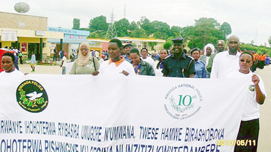 Ruhango students join Police and local leaders in a peaceful march against gender based violence. (Photo: D. Sabiiti)