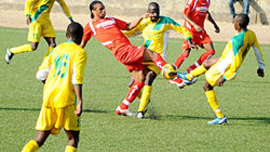 Simba's Kelvin Yondan fights for the ball with Atraco players. Simba won the contest 2-1 to boost their chances of reaching the quarters. (Photo/ F. Goodman)