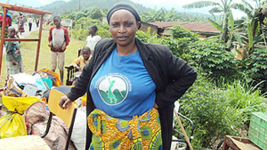 STRANDED; Patricia Nyirasavena with her household property after her house was destroyed by the floods in the Northern Province (Photo R Mugabe)