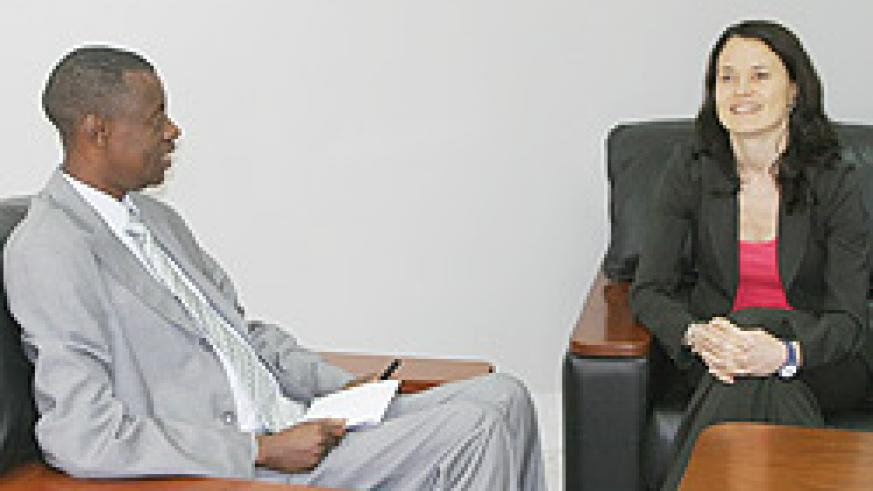 Defence Minister, Gen. James Kabarebe and Catherine Wiesner during their meeting yesterday. (Courtesy Photo)