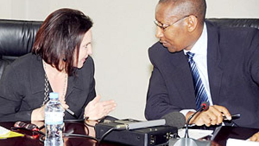 Minister of Finance John Rwangombwa (R) talks to the Head of DFID in Rwanda Elizabeth Carriere at the press conference yesterday. (Photo / J. Mbanda)