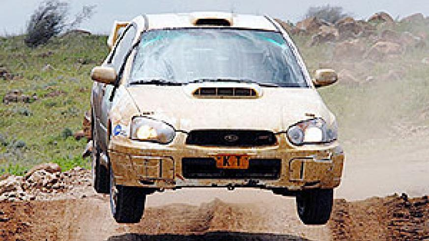 Jamie Whyte powers his machine during the KCB Pearl of Africa Uganda rally.