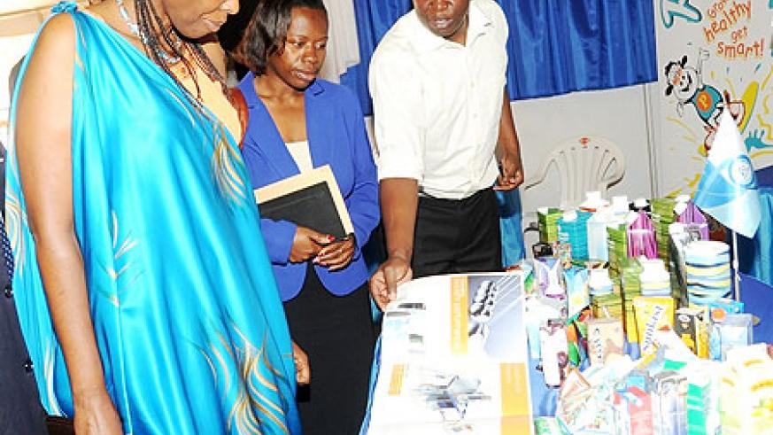 Ministers Agnes Kalibata of Agriculture and Monique Nsanzabaganwa of Commerce   inspect  products at the Diary Exhibition.(File Photo)