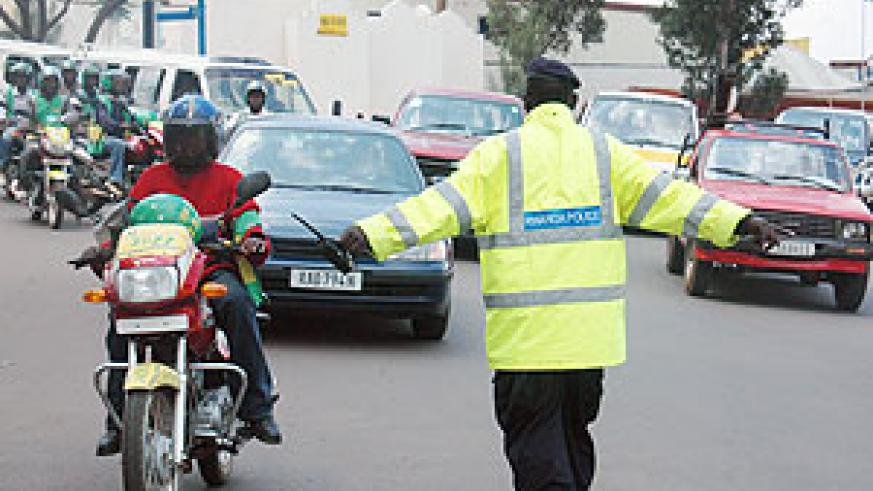 Hard at work. A Rwanda Traffic Policeman