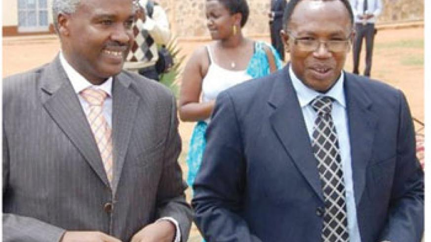 Former minister of education , mr. Muligande charles and headmaster of lycee de kigali masabo m. Martin (r).