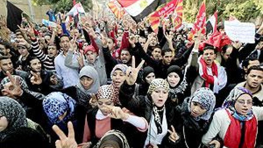 Egyptians chant slogans as thousands march in a protest from Al-Ahly club to the headquarters of the ministry of interior in Cairo on Thursday. Net photo.