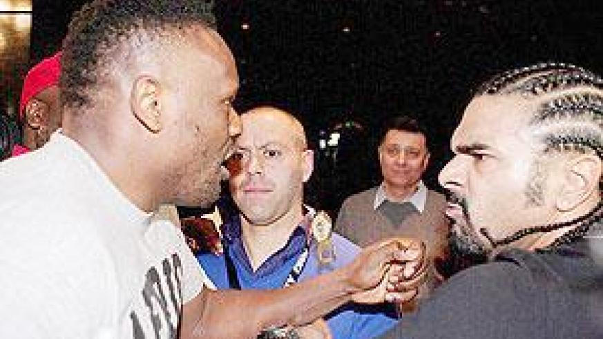 Dereck Chisora threatens to shoot and burn David Haye after a clash following Chisora's loss to Vitali Klitschko in Munich. Net photo.