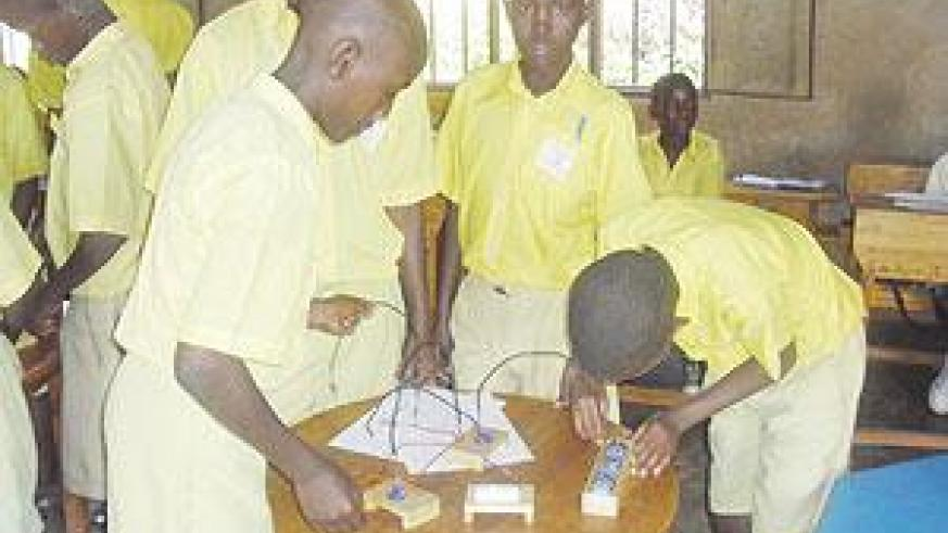 Students in a practical physics lesson. Practical-oriented educational training is what creates a hands-on labour force.  The New Times / File.