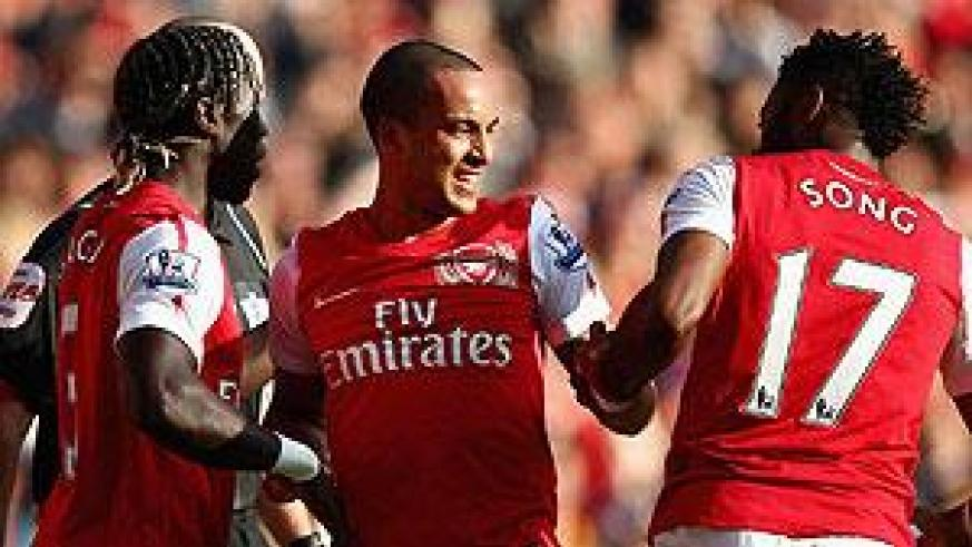 Arsenal fought back from two goals down to see off rivals Tottenham 5-2, with Walcott among the goals scores with a brace. Net photo