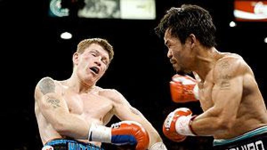 Ricky Hatton goes to the ground after a strong righthand from Manny Pacquiao. Net photo.