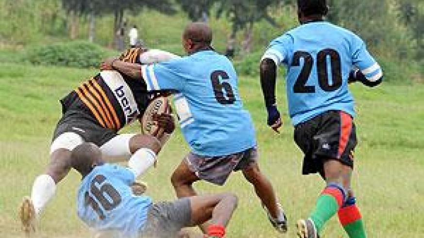 Sharks players take down a Buffalo player in an earlier tournament. The New Times / Timothy Kisambira.