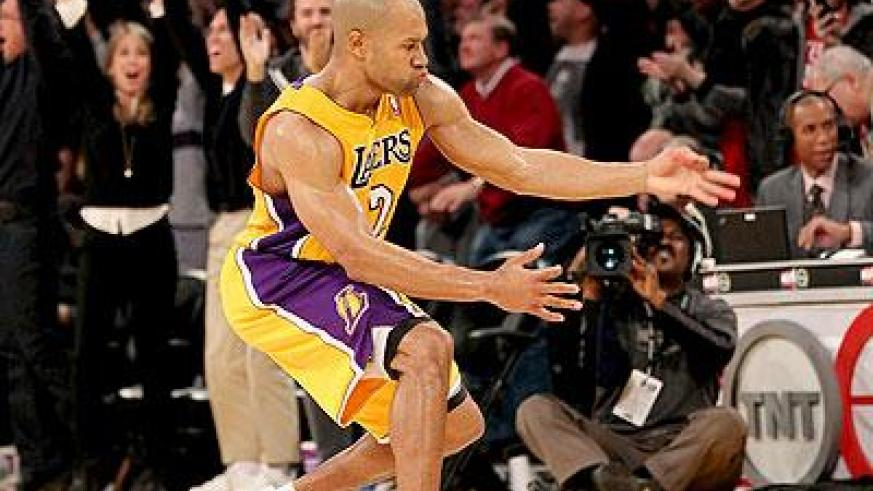 The Lakers have traded Derek Fisher (above) and a first round pick to the Houston Rockets for Jordan Hill. Net photo