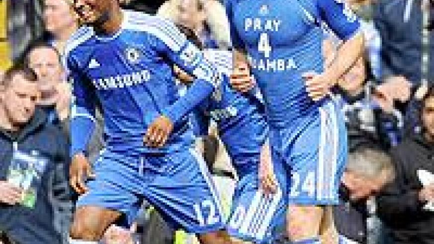 John Obi Mikel celebrates with goal scorer Gary Cahill who shows his support for Fabrice Muamba during the FA Cup sixth round match between Chelsea and Leicester City. Net photo.