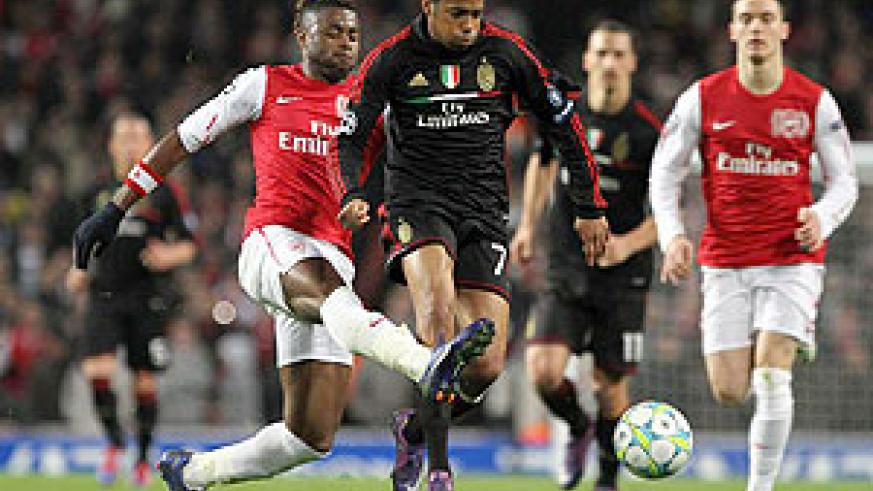 Robinho vies with Alexandre Song during their UEFA Champions League match. Milan will be looking to extend their lead. Xinhua