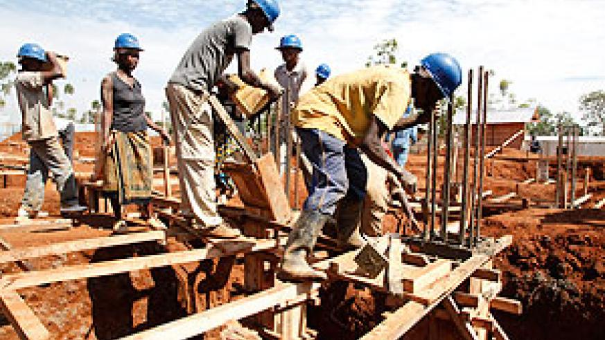 Builders at a construction site in Kigali. The pension reforms seek to enable saving even for such workers. The New Times/ File.